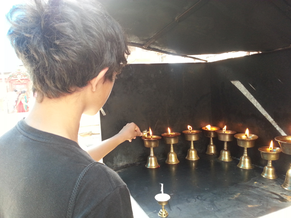 Offering prayers and lighting diyas as we went through the city.  Learning about where he came from, learning from mom and grandma, going back straight to his roots.  Soaking it all in, the culture, the sights and sounds and smell and a feeling of pride he has always had to be a part of Nepal!