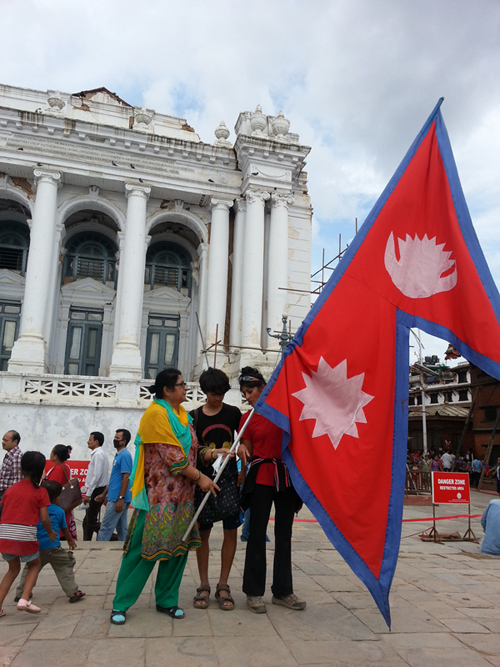 Coincidentally, there was a guy letting people hold the giant Nepali flag and we did not miss this opportunity.  A moment of pride!
