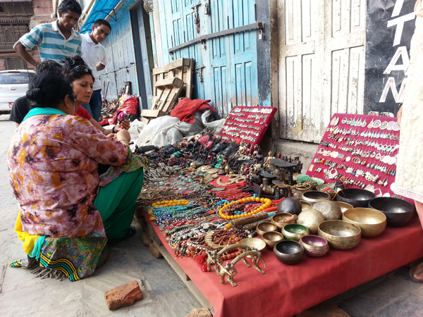 The market place surrounding Kasthamandab. You almost want to buy everything and bring it back.  We shopped a little and brought home some momentos. You buy, you support a family to feed their family.  You put money into the Nepalese economy.  The tourism industry has taken a big hit.  The places we visited used to be full of tourists hustling and bustling. It does not feel unsafe, I would go again!