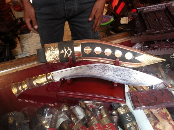 """One momento I had to bring back home! The Nepali Khukuri that the brave Gurkha's carry!  It may or may not be the real deal but I am content just to share the story with my family with pride!     From Wikipedia, the free encyclopedia:   The former Indian Army Chief of Staff Field Marshal Sam Manekshaw, once stated that[6] """"If a man says he is not afraid of dying, he is either lying or is a Gurkha."""" Naturally warlike and aggressive in battle; to possess qualities of courage, loyalty, self-sufficiency, physical strength, resilience, orderliness; to be able to work hard for long periods of time; and to fight with tenacity and military strength. Professor Sir Ralph Lilley Turner, MC, who served with the 3rd Queen Alexandra's Own Gurkha Rifles in the First World War, wrote of Gurkhas: """"As I write these last words, my thoughts return to you who were my comrades, the stubborn and indomitable peasants of Nepal. Once more I hear the laughter with which you greeted every hardship. Once more I see you in your bivouacs or about your fires, on forced march or in the trenches, now shivering with wet and cold, now scorched by a pitiless and burning sun. Uncomplaining you endure hunger and thirst and wounds; and at the last your unwavering lines disappear into the smoke and wrath of battle. Bravest of the brave most generous of the generous, never had country more faithful friends than you."""""""