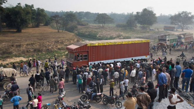 BBC News, February 5th, 2016: Bystanders watched trucks pass through the border at Birgunj, about 90km south of Kathmandu